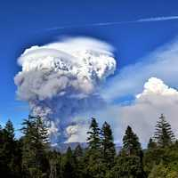 Mushroom Smoke Cloud rising up from the forest fire