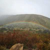 Rainbow under the mountain landscape