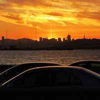 Sunset over the skyline and cars in San Francisco, California