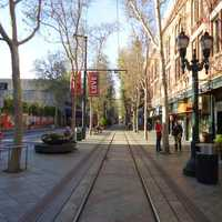Downtown San Jose sidewalk in San Jose, California with trees and buildings