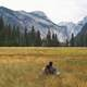 Couple looking at landscape in Yosemite National Park, California