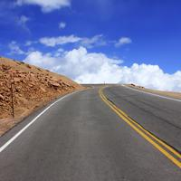 Roadway and blue sky at Pikes Peak, Colorado
