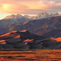 Alpenglow on Dunes and Crestone Peaks