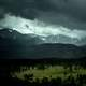 Mountain and forest landscape in Colorado under stormy skies