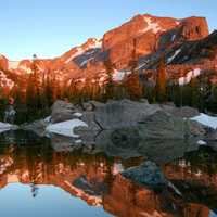 Hallet's Peak reflected in Lake Haiyaha at dawn in Rocky Mountain National Park