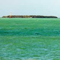 Island among blue-green water in Key West, Florida