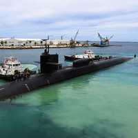 Submarines and ships at Guam Harbor