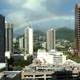 Rainbow over city buildings in Honolulu, Hawaii