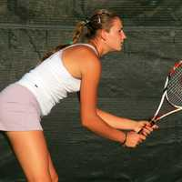 Girl ready to return a volley in tennis