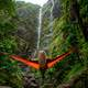 Watching the Waterfall in a Hammock in Hawaii