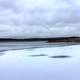 Ice, lake, and clouds at Shabbona Lake State Park