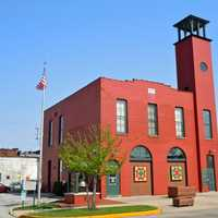 Historic fire station with patchwork quilt designs on doors in Indiana
