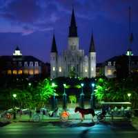 New Orleans evening city with horse carriages in Louisiana