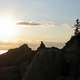 Guy watching sunset on the rocks at Acadia National Park, Maine