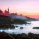 Ogunquit sunset over misty seashore in Maine