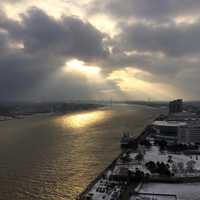 Sun shining through the clouds on the river in Detroit, Michigan