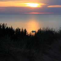 Sunset over lake and forest at Pictured Rocks National Lakeshore, Michigan