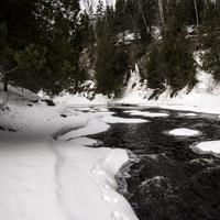 Flowing Cascade River in the winter at Cascade River State Park, Minnesota