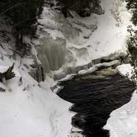 Small Pool beneath a waterfall in the winter as Cascade River State Park, Minnesota