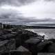 Rocky Shoreline with stormy waters in Duluth, Minnesota