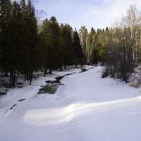 Downstream with snow and ice on the Gooseberry River at Gooseberry falls State Park, Minnesota