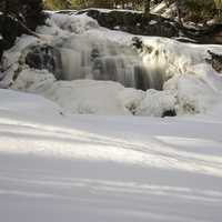 Rushing waterfalls in the snow and ice at Gooseberry Falls State Park, Minnesota