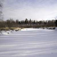 Snowy River Landscape with trees and sky at Gooseberry Falls State Park, Minnesota