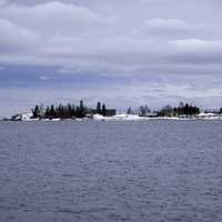 Peninsula with trees and houses on Lake Superior in Grand Marais, Minnesota
