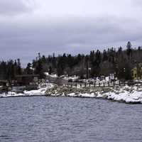 Winter shoreline and pine forest in Grand Marais, Minnesota