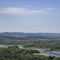 River flowing through the valley landscape at Great River Bluffs State Park