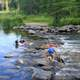 Children playing in the rapids at lake Itasca state park, Minnesota