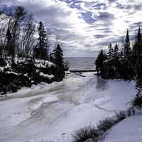 Scenery of the Temperance River flowing into lake Superior in ice and snow in Minnesota