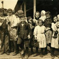 Children employed as oyster shuckers at Pass Packing Company in 1911, Mississippi