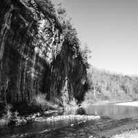 Monochrome photo of current river and cliff at Echo Bluff State Park, Missouri