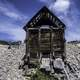 Old Rustic Cabin under blue sky and clouds in Elkhorn, Montana