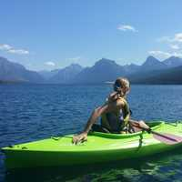 Girl Canoeing on Lake McDonald at Glacier National Park, Montana