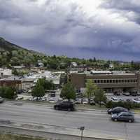 Cars and buildings under cloudy sky in Helena, Montana