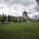 Montana State Capital under the clouds with lawn in Helena