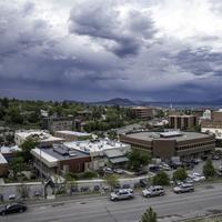 Town of Helena under heavy clouds with mountains in the background