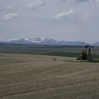Farm Machinery with mountains in the background in Montana