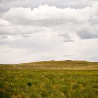 Landscape and mound with clouds in Montana