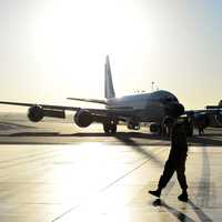 Airman and airplane at the airport or base