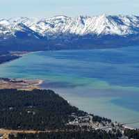 Snow-capped Mountains landscape and the bay of Lake Tahoe