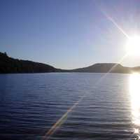 Sun over Christine Lake in Shark, New Hampshire