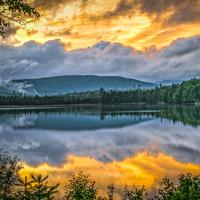 Sunrise over the lake and mountains in the Adirondacks