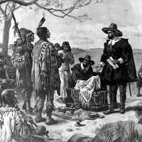 Peter Minuit purchasing Manhattan from the Indians in New York