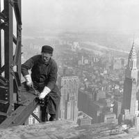 A construction worker on top of the Empire State Building as it was being built in 1930 in New York