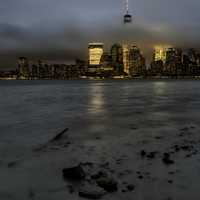 New York City Skyline under dark storm clouds