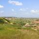 Grassland landscape with badlands in the distance at Theodore Roosevelt National Park, North Dakota