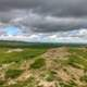 Clouds and trail to the horizon at White Butte, North Dakota